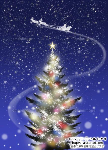 色々な色に光るクリスマスツリーとソリに乗ったサンタクロース