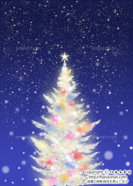 色々な色に光る白いクリスマスツリー