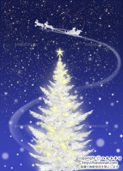 白いクリスマスツリーとソリに乗ったサンタクロース